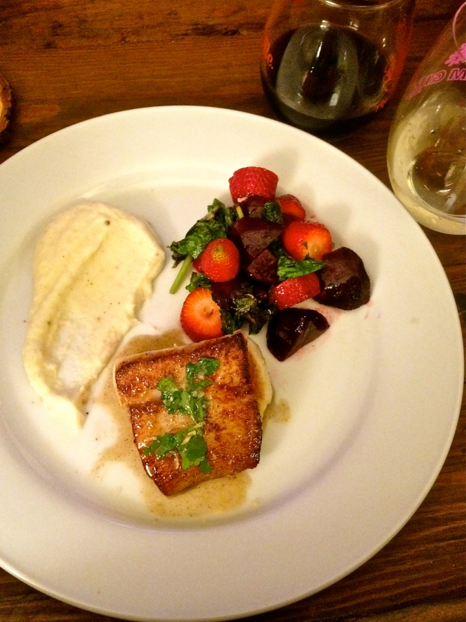 Seared sea-bass with champagne beurre blanc, truffled parsnip puree, beet strawberry turnip green salad