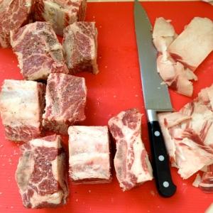 Trim fat off of spare ribs and cut individual portions between bones