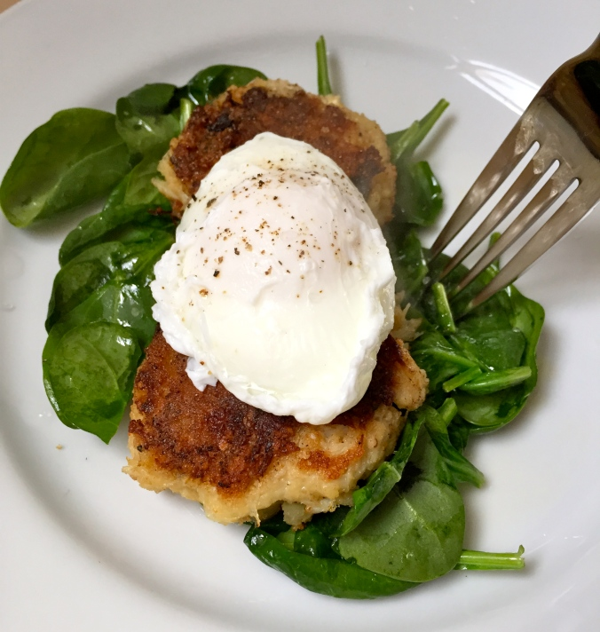 Paleo Crab Cakes over spinach (tossed with olive oil and lemon juice) and topped with poached eggs